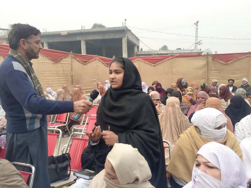 a woman speaks during the public hearing khuli katchery held in charsadda photo express