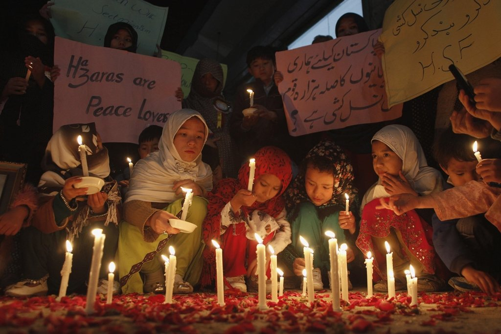 Members of a Hazara community light candles for peace against sectarian attacks in Quetta February 15, 2014. PHOTO: REUTERS