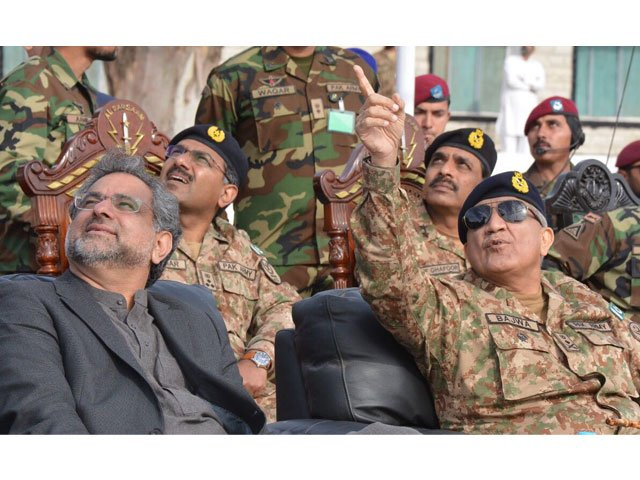 PM Abbasi also fired few weapons used by SSG. PHOTO: FILE