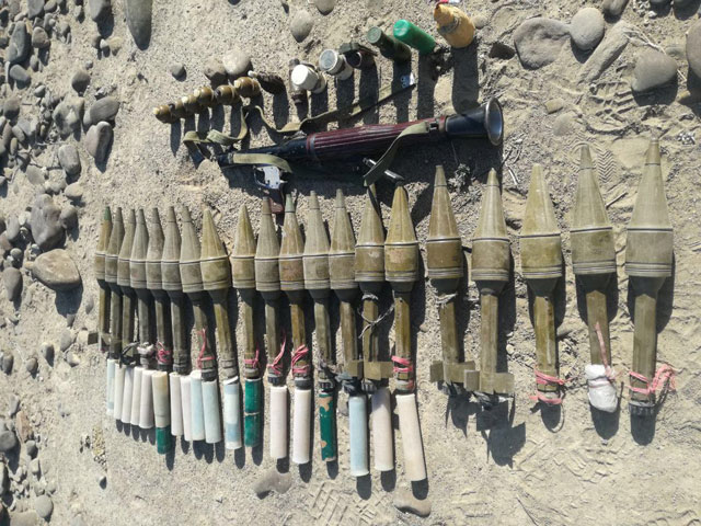 Weapons and ammunition including grenades, IEDs, rockets and explosives recovered. PHOTO: ISPR