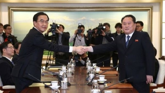 head of the north korean delegation ri son gwon shakes hands with his south korean counterpart cho myoung gyon during their meeting at the truce village january 9 2018 photo reuters