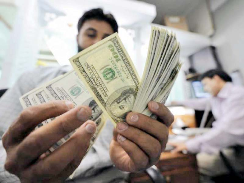 As the rupee depreciates, people are less inclined to block their savings in a low interest-bearing scheme and gradually move towards converting to dollars. PHOTO: FILE