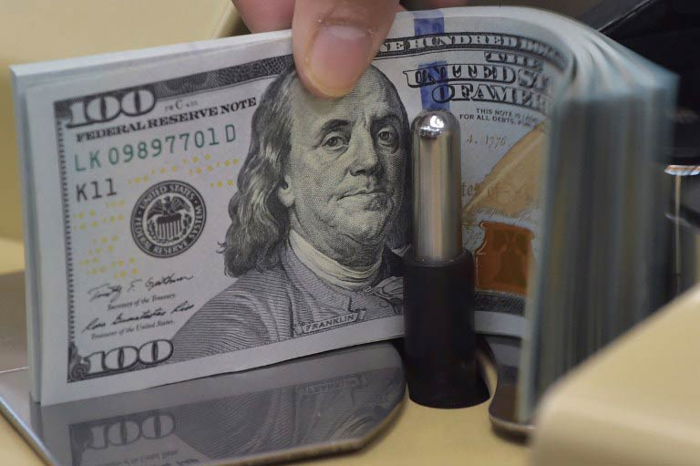 decrease attributed to payments on account of external debt servicing photo afp