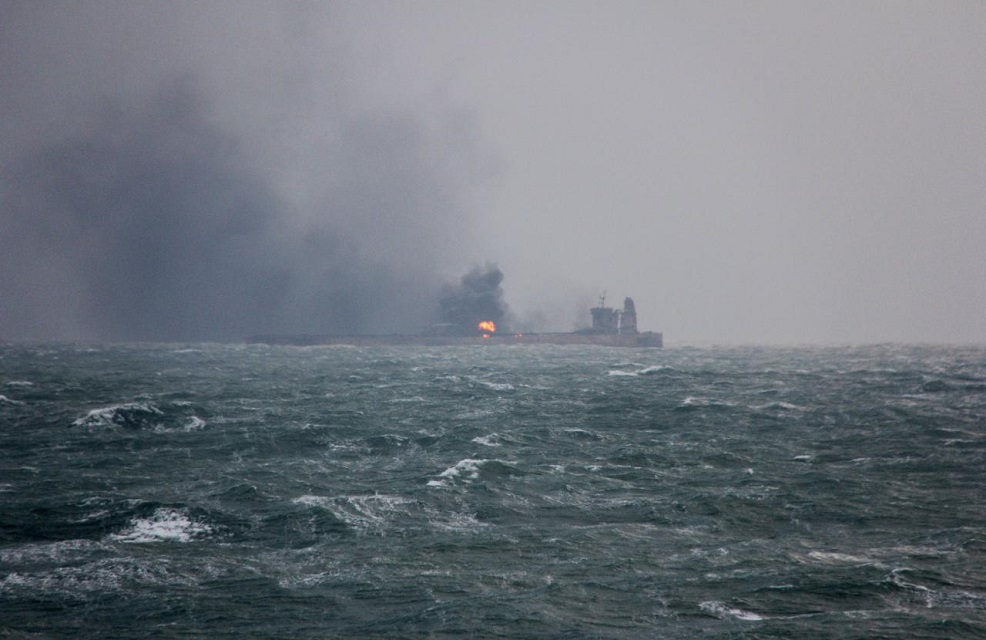 smoke is seen from panama registered sanchi tanker carrying iranian oil that caught ablaze after it collided with a chinese freight ship in the east china sea in this january 9 2018 handout picture released by china 039 s ministry of transport photo reuters