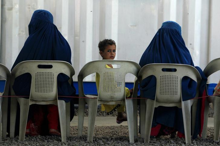Afghan refugees are seen at UNHCR's Voluntary Repatriation Centre in Peshawar, Pakistan. PHOTO: REUTERS