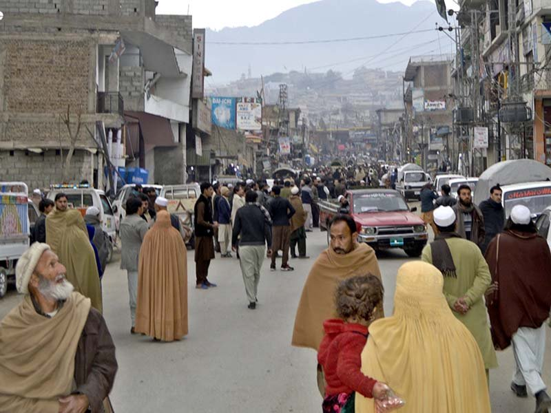 people rush out of their homes and shops as tremors jolt the city in lower dir photo inp