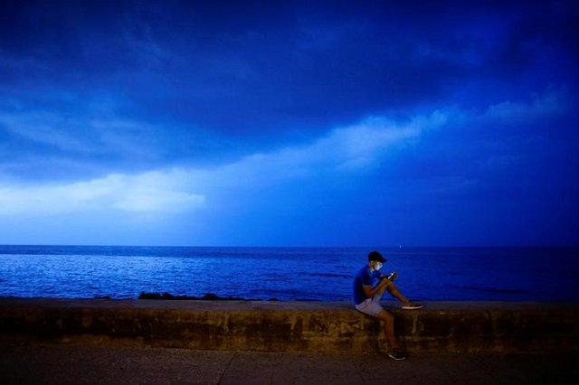 a man connects to an internet hotspot at the sea front at the malecon in havana cuba august 4 2017 photo reuters