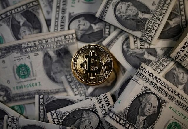 a bitcoin virtual currency coin placed on dollar banknotes is seen in this illustration picture november 6 2017 photo reuters