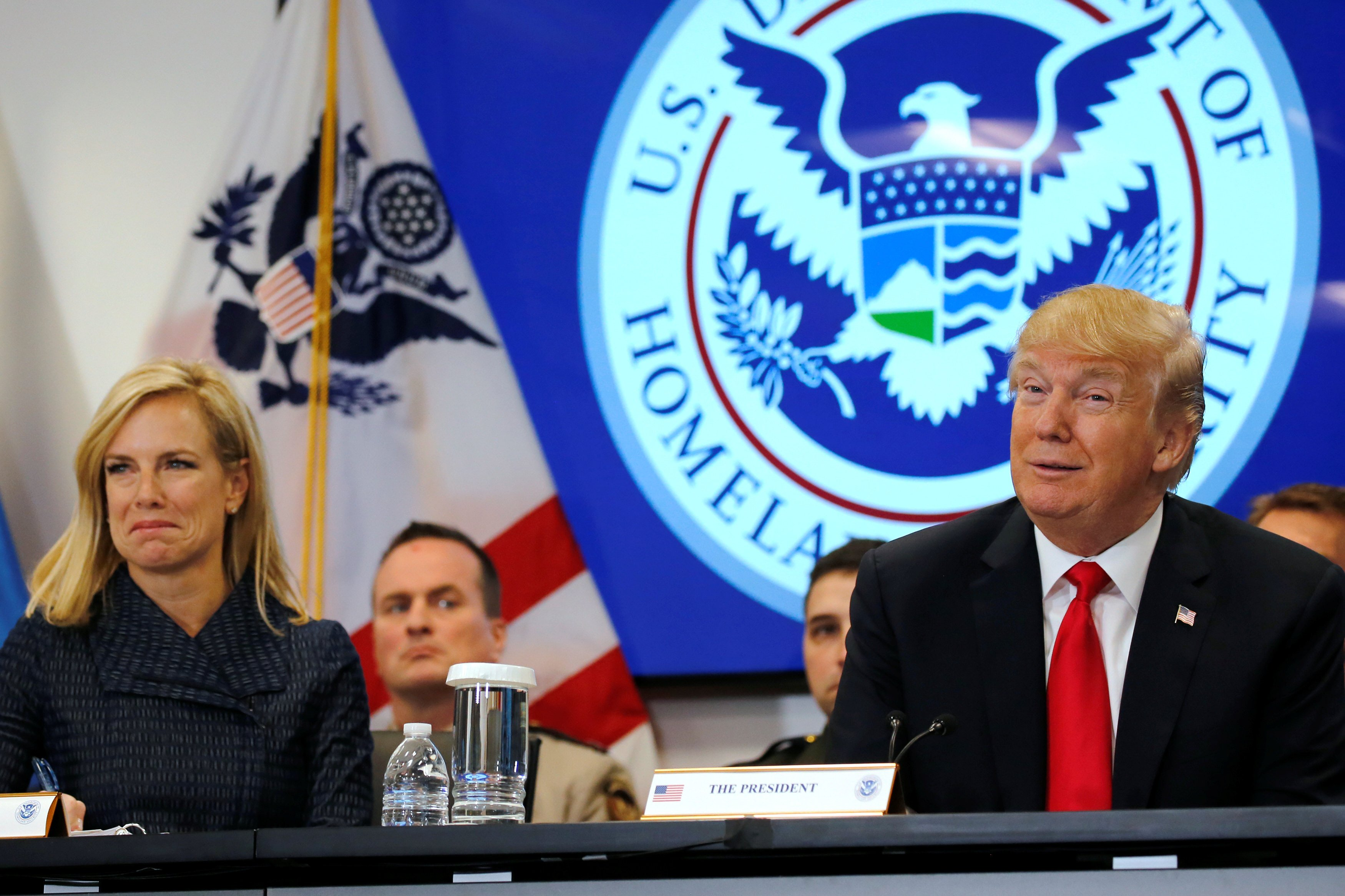 u s president donald trump flanked by secretary of homeland security kirstjen nielsen holds a meeting at the u s customs and border protection 039 s national targeting centre in sterling virginia u s february 2 2018 photo reuters
