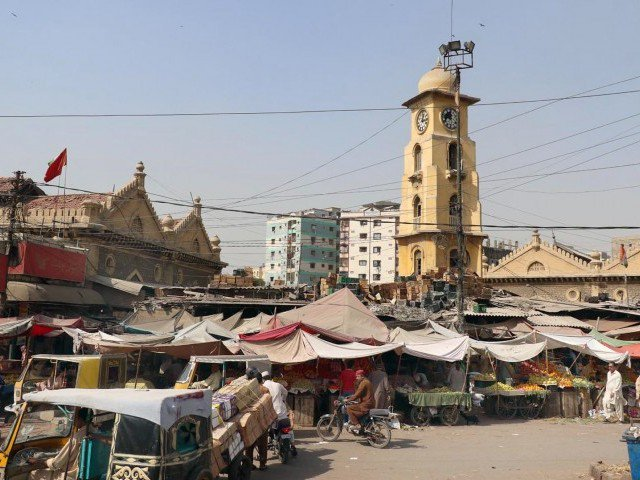 lea market in karachi is overrun with encroachments and street side stalls and the sc wants the kmc to remove all such illegal set ups photo online