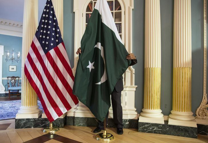 a state department contractor adjust a pakistan national flag before a meeting at the state department in washington photo reuters