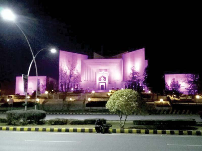 pink lights on supreme court building on the eve of world cancer day photo mudassar raja