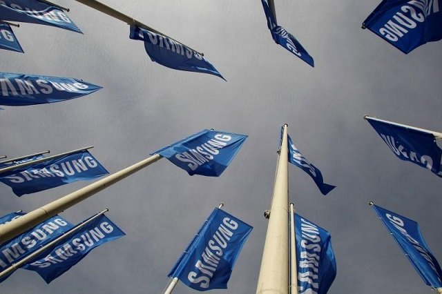 samsung flags are set up at the main entrance to the berlin fair ground before the ifa consumer electronics fair in berlin august 28 2012 photo reuters