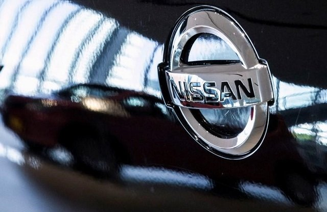 a car is reflected in the bonnet of a nissan car in the showroom at nissan 039 s global headquarters in yokohama south of tokyo february 9 2015 photo reuters