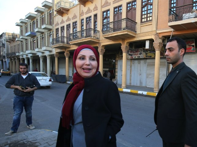 baghdad mayor thikra alwash 60 year old civil engineer and only woman mayor of a middle east capital speaks to civilians during a tour at al rashid street in the iraqi capital on january 29 2018 thikra wants to revive her war torn city fix its decrepit infrastructure and twin it with paris    another female led metropolis photo afp