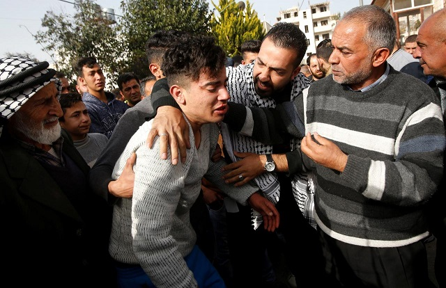 relatives of palestinian assailant react outside his house near hebron in occupied west bank february 7 2018 photo reuters
