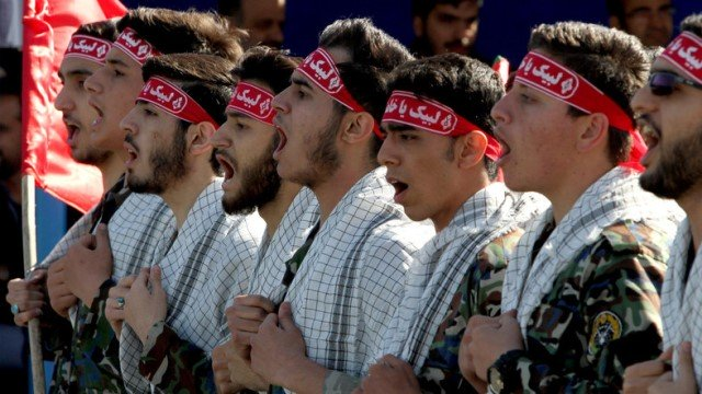iranian members of the basij militia march during a parade marking the country s army day on april 18 2017 in tehran photo afp