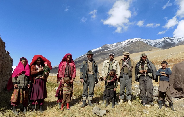 this photograph taken on october 8 2017 shows afghan wakhi nomad family posing for a picture in the wakhan corridor in afghanistan the region is so remote that its residents known as the wakhi   a tribe of roughly 12 000 nomadic people who populate the area   are untouched by decades of conflict devastating their country photo afp