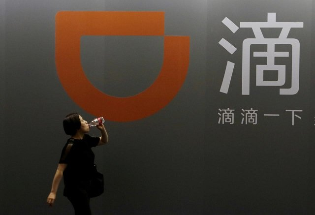 china s didi softbank to roll out taxi venture in japan