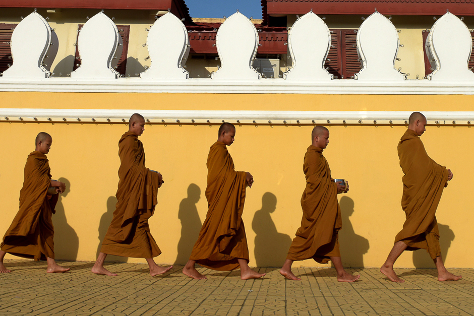 buddhist monks walk in front of the royal palace in phnom penh photo afp file