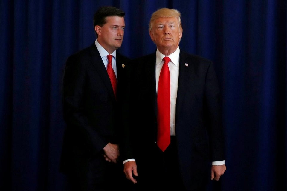 white house staff secretary rob porter l reminds us president donald trump he had a bill to sign after he departed quickly following remarks at his golf estate in bedminster new jersey us august 12 2017 photo reuters file