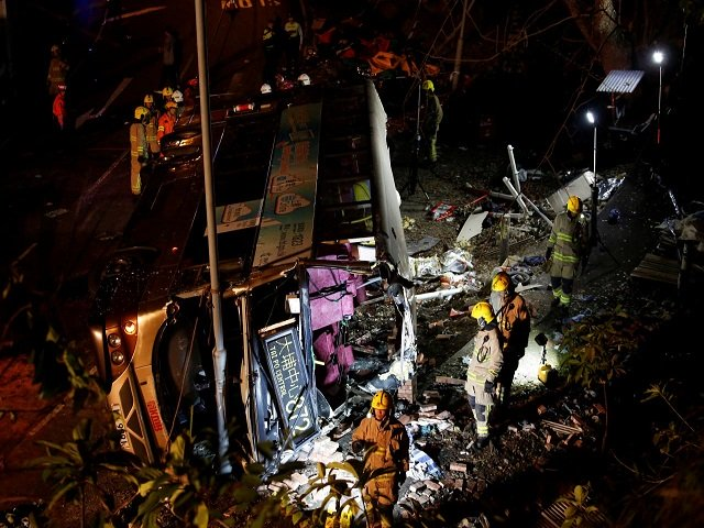 rescuers walk beside a crashed bus in hong kong china february 10 2018 photo reuters