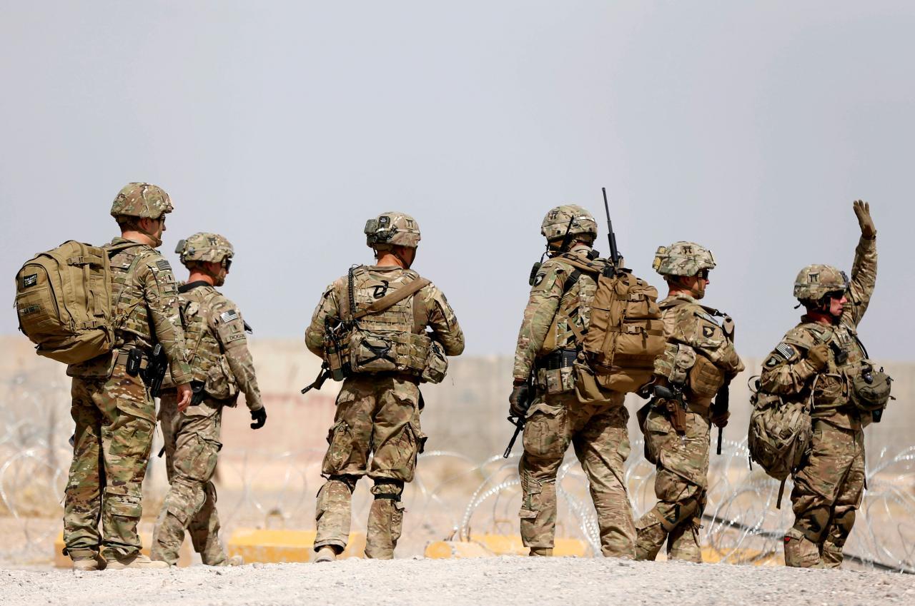 us troops walk outside their base in uruzgan province afghanistan photo reuters