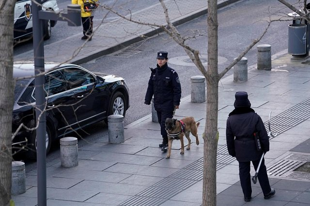 police patrol outside the joy city mall in the xidan district after a knife attack in beijing china february 11 2018 photo reuters