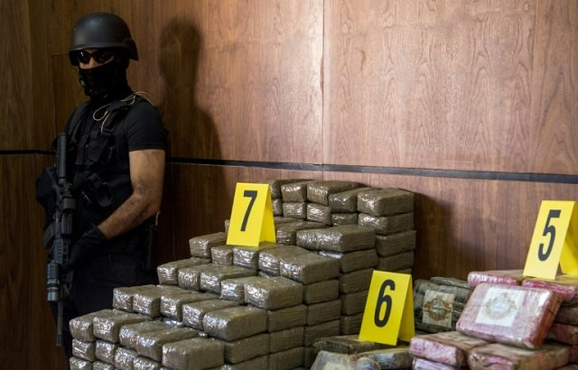 seized drugs and weapons are displayed by morocco 039 s central bureau of criminal investigation in marrakesh on october 4 2017 photo afp