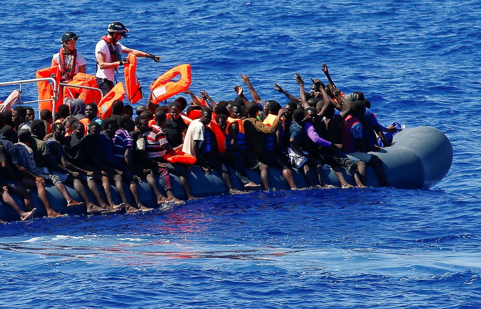 migrants on a rubber boat are rescued by sos mediterranee organisation during a search and rescue sar operation with the mv aquarius rescue ship not pictured in the mediterranean sea off the libyan coast photo reuters