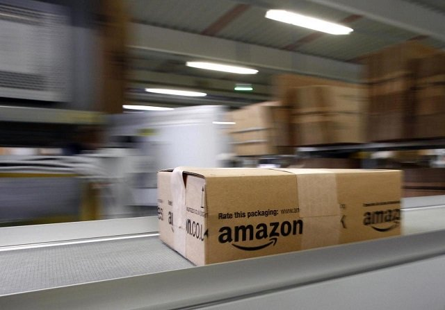 a parcel moves on the conveyor belt at amazon 039 s logistics centre in graben near augsburg december 16 2013 workers at amazon com 039 s german operations were set to go on strike on monday in the middle of the crucial christmas holiday season in a dispute over pay that has been raging for months the verdi union said workers would strike in amazon 039 s logistic centres in bad hersfeld and leipzig and for the first time in graben photo reuters