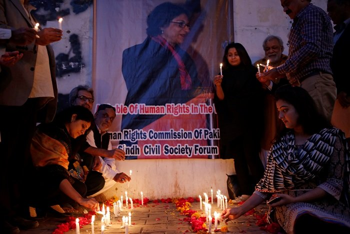 civil society members lighting candles at a vigil organised in memory of human rights activist and lawyer asma jahangir outside the karachi press club photo reuters