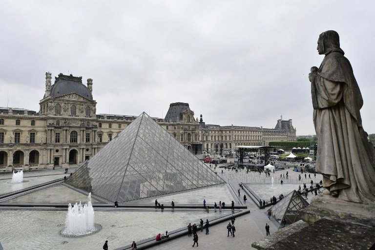 a general view shows the stage set up by france 039 s en marche movement at the pyramid of the louvre museum photo afp