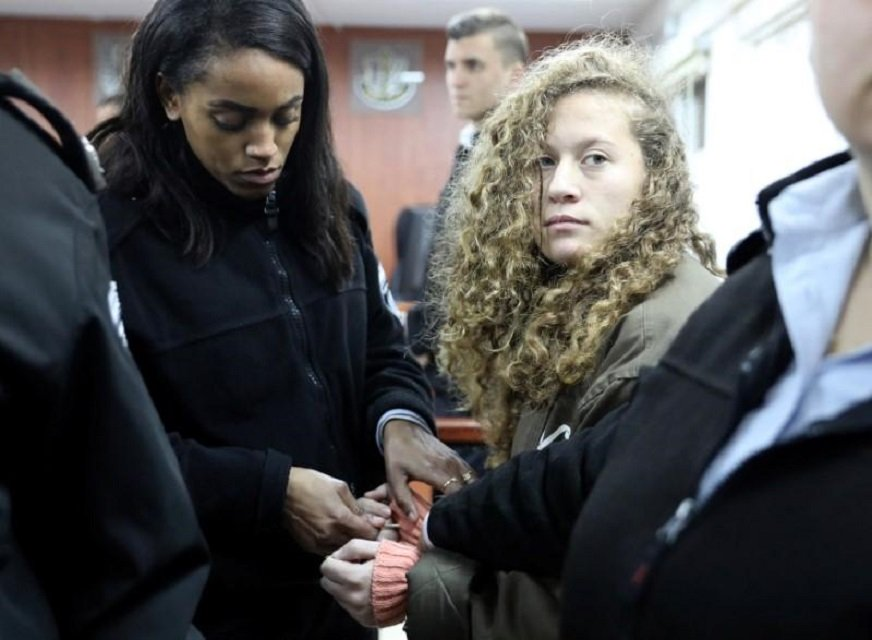 palestinian teen ahed tamimi r enters a military courtroom escorted by israeli prison service personnel at ofer prison near the west bank city of ramallah january 1 2018 photo reuters