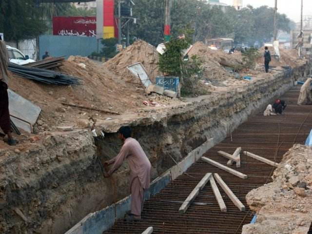 development work for green line bus rapid transit project being done on ma jinnah road in karachi photo file