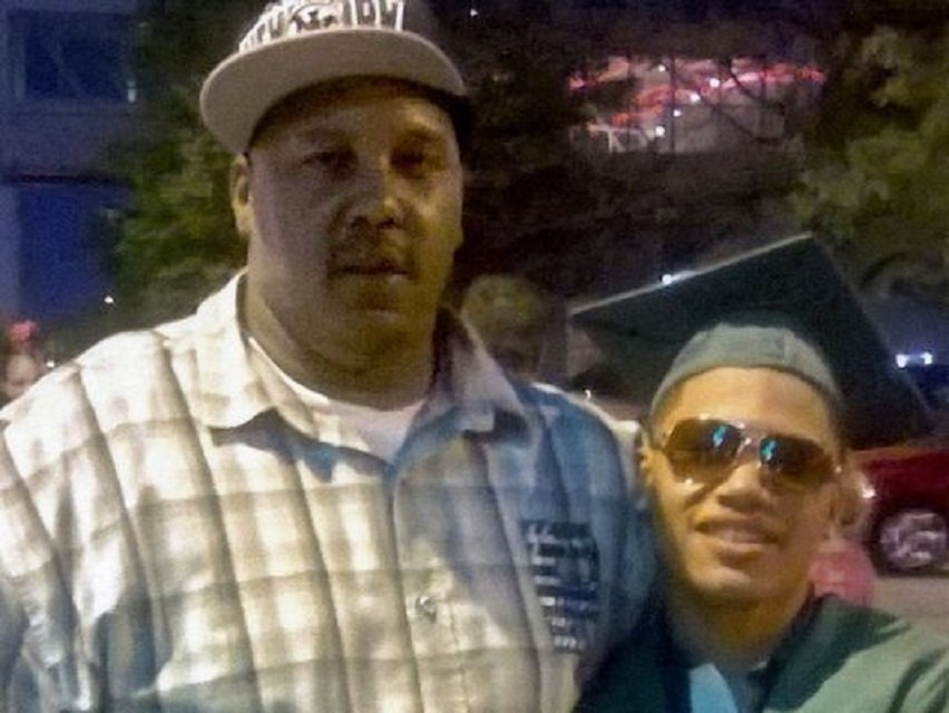terrill thomas left stands with his 20 year old son also named terrill at the son 039 s high school graduation in 2014 the father died in april 2016 while in milwaukee county jail photo courtesy usatoday thomas family