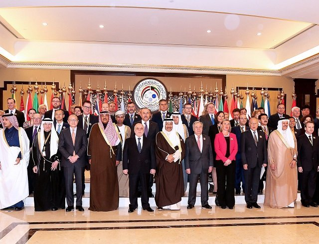 kuwaiti foreign minister sheikh sabah al khaled al sabah c stands next to iraq prime minister haider al abadi eu foreign policy chief frederica mogherini un secretary general antonio guterres as they pose with other officials for a group photo on the second day of an international conference for reconstruction of iraq in kuwait city on february 14 2018 photo afp