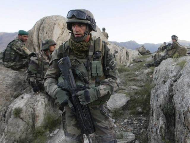 a file picture taken on september 21 2010 shows a french soldier c patroling with afghan soldiers in kapisa province in afghanistan photo afp