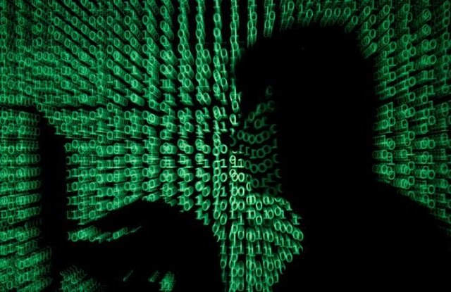 a man holds a laptop computer as cyber code is projected on him in this illustration picture taken on may 13 2017 photo reuters