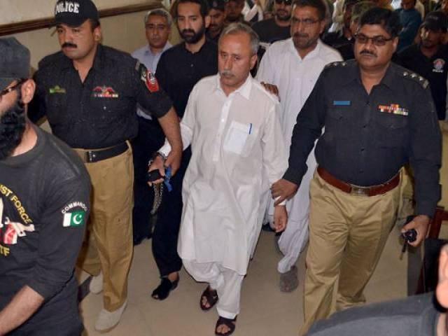 police escort former finance secretary balochistan mushtaq raisani out of an accountability court in quetta on may 7 2016 photo inp