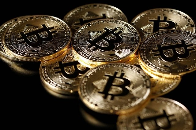 a collection of bitcoin tokens on display in a picture illustration photo reuters