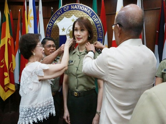 geraldine roman 50 who became the catholic majority nation 039 s first transgender person elected to congress in 2016 took her oath on wednesday photo afp handout