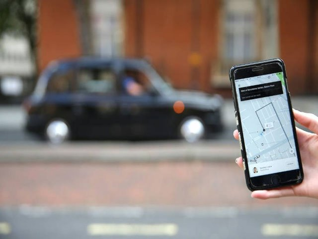 Uber is fighting to keep its licence in London. PHOTO: AFP