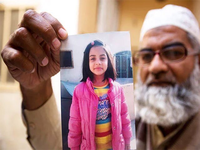 zainab 039 s father holds his daughter 039 s photo file