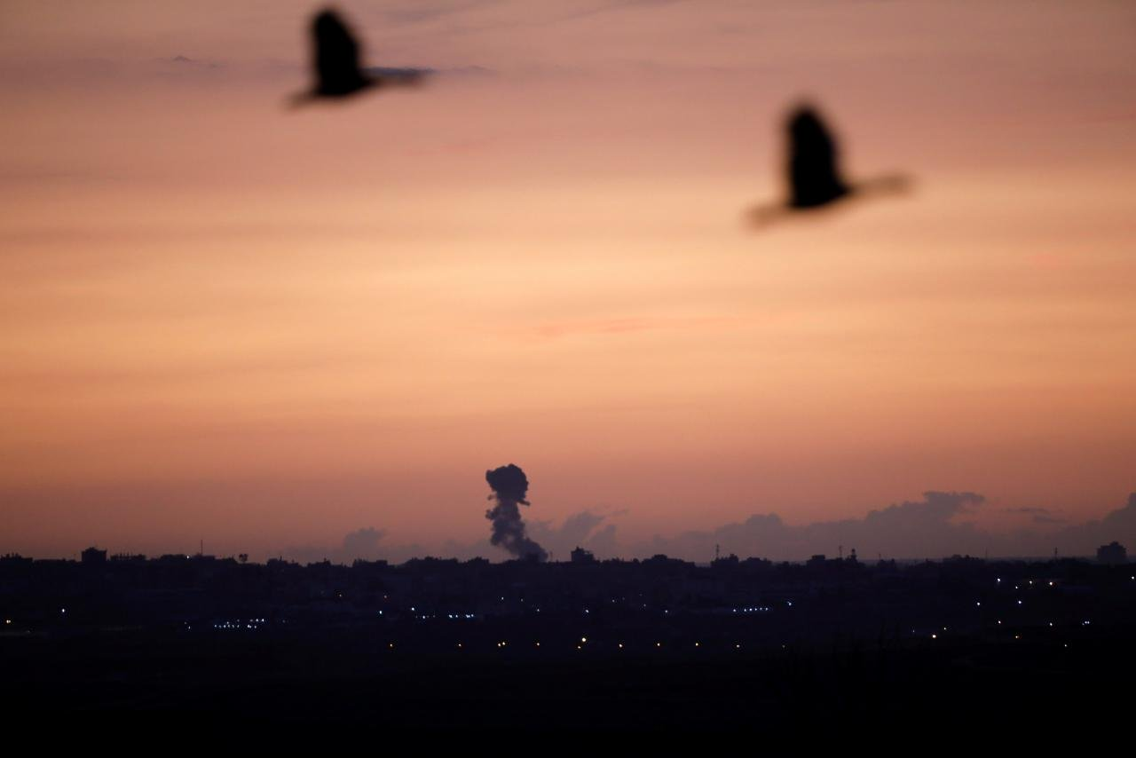 smoke rises at the gaza strip following an israeli strike as seen from the israeli side of the border photo reuters