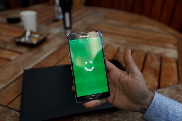 an employee shows the logo of ride hailing company careem on his mobile in his office in the west bank city of ramallah july 17 2017 picture taken july 17 2017 photo reuters