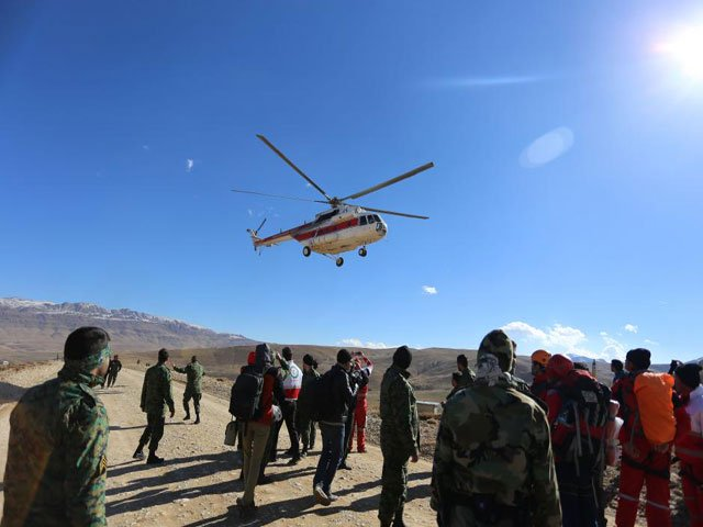 members of emergency and rescue team search for the plane that crashed in a mountainous area of central iran february 19 2018 photo reuters