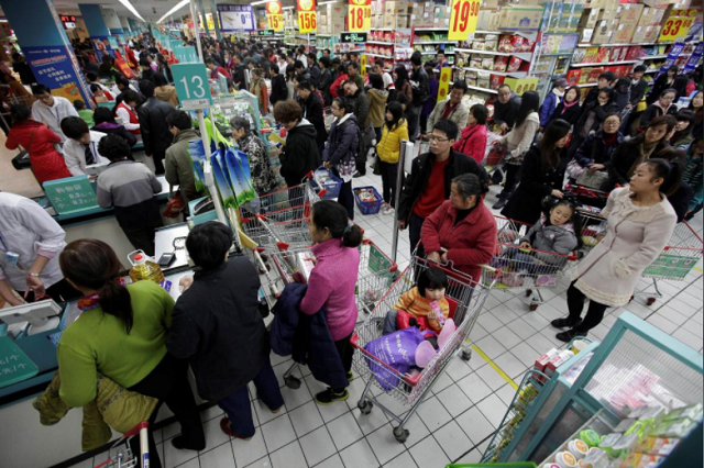 customers queue to pay as they shop at a carrefour supermarket in wuhan hubei province december 3 2011 photo reuters
