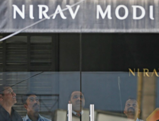 security guards stand inside a nirav modi showroom during a raid by the enforcement directorate a government agency that fights financial crime in new delhi india february 15 2018 photo reuters