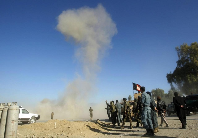 smoke rises in the sky after afghan security forces detonated an explosive device at the site of a blast in jalalabad city november 10 2014 photo reuters